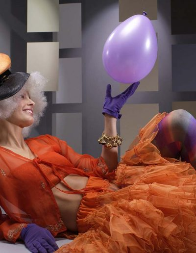conceptual-photographer-with-clown-model-1295x844